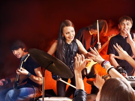 young musician: Musical group male and female  performance in night club.