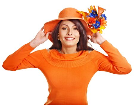 Woman wearing orange sweater and hat. Isolated. photo