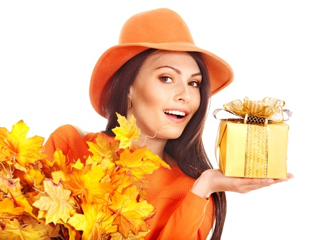 Woman holding gift box . Autumn season. photo