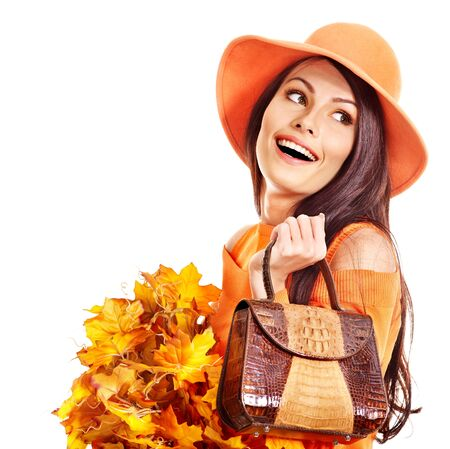 Woman holding  orange leaf and handbag. Autumn fashion. Stock Photo - 15719053