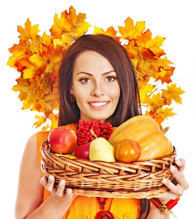 Woman holding autumn basket with fruit and vegetable. Stock Photo - 15719113