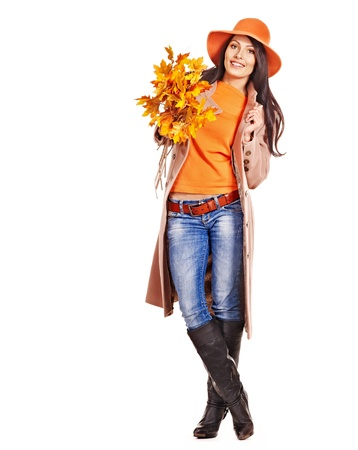 Woman wearing overcoat holding  orange leaves. photo