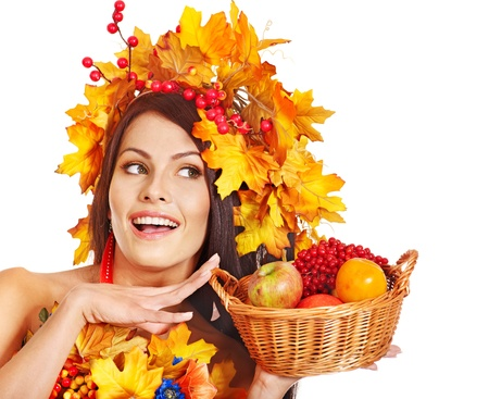 Girl with wreath of autumn leaves holding basket with fruit. Stock Photo - 15719098
