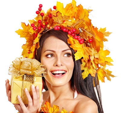 Girl with wreath of autumn leaves on the head. Art photo. Stock Photo - 15719127