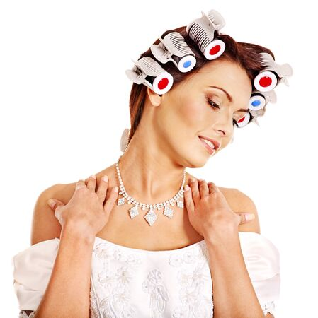 hot rollers: Woman with hair curlers on head wear in wedding dress . Stock Photo