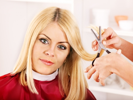 hairdresser parlor: Woman in hairdressing salon do hair style.
