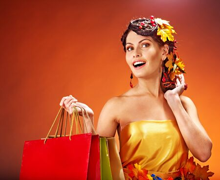 Girl with  autumn hairstyle and shopping bag. Stock Photo - 15718997