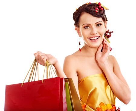 Girl with  autumn hairstyle and shopping bag. Stock Photo - 15718980