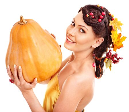 Woman holding big autumn pumkin. Isolated. photo