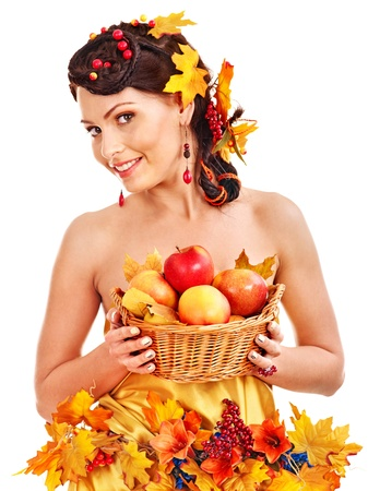 Girl with wreath of autumn leaves holding basket with fruit. Stock Photo - 15718949