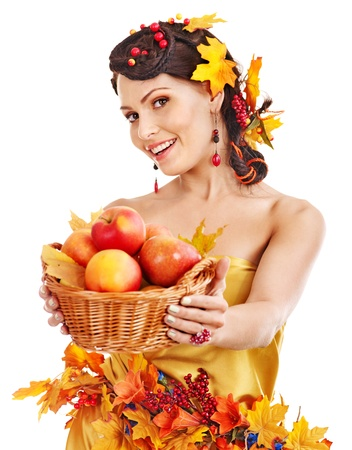 Girl with wreath of autumn leaves holding basket with fruit. Stock Photo - 15719011