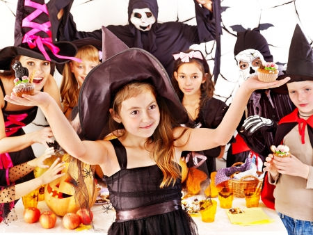 Halloween party with children holding carving pumpkin photo