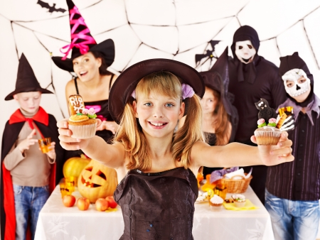 Halloween party with group children holding trick or treat. photo