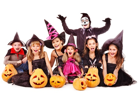 treat: Halloween party with group children holding carving pumpkin. Isolated.