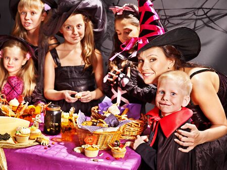 Family on Halloween party with children making carved pumpkin. Stock Photo - 15719046