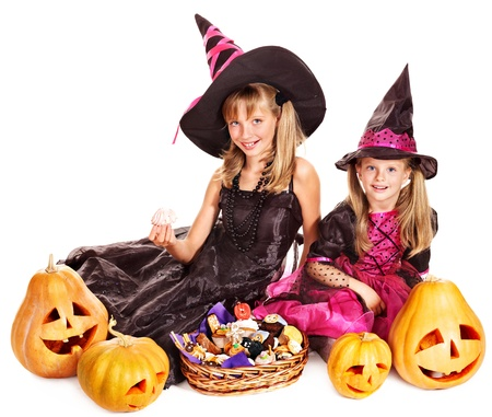 Happy group witch children at Halloween party. Isolated. photo