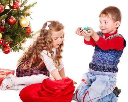 Children with  gift box and sweet. Isolated. photo