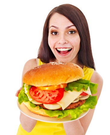 high calorie foods: Woman holding hamburger. Isolated. Stock Photo