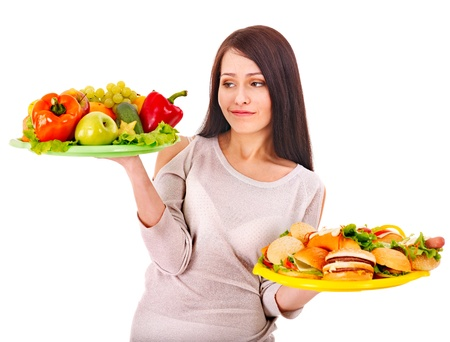 Woman choosing between healthy and unhealthy eating. Stock Photo - 15832427