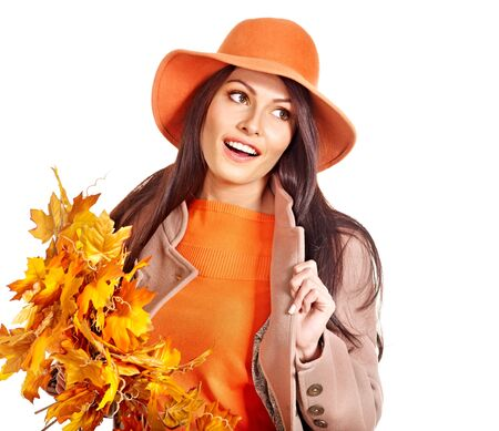 Woman wearing overcoat holding  orange leaves. Stock Photo - 15832403