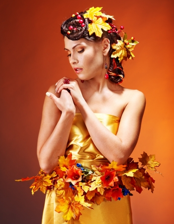 Girl with  autumn hairstyle and make up. Fashion glamour. photo
