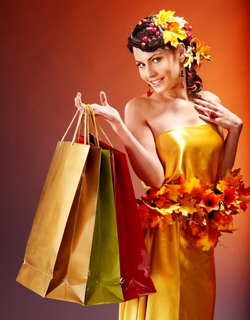 Girl with  autumn hairstyle and shopping bag. Stock Photo - 15896928