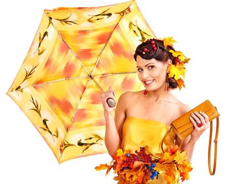 yellow umbrella: Girl with autumn hairstyle and umbrella. Fashion glamour.