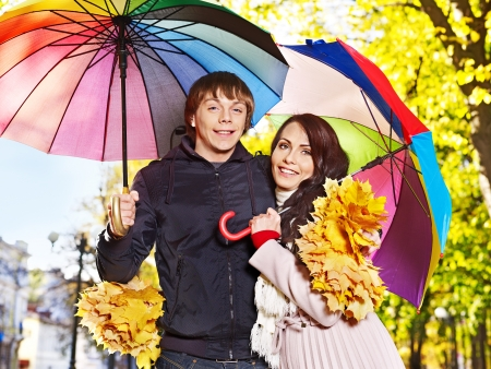 Couple holding umbrella  autumn outdoor. photo