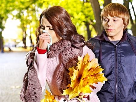 handkerchief: People sneezing handkerchief autumn outdoor . Stock Photo