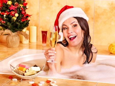 jacuzzi: Woman in Santa hat relax in bath. Christmas concept.