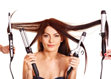 curling: Young woman holding iron curling hair. Isolated.