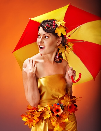 Woman with autumn hairstyle and umbrella. Fashion glamour. Stock Photo - 15917725