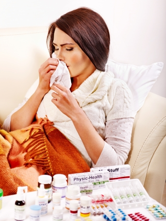 hanky: Woman with remedy having  flue in bed. Isolated. Stock Photo