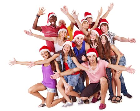 Happy group people in Santa hat . Isolated. photo