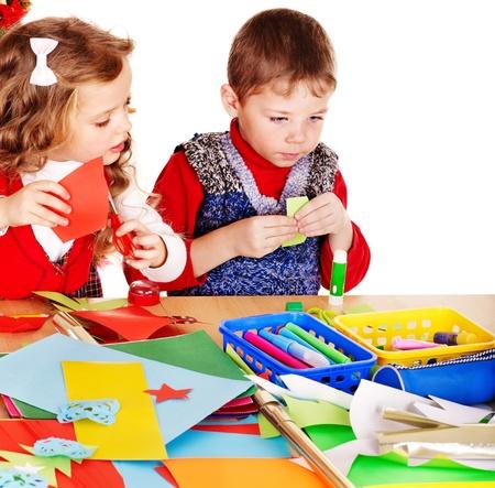 kindergarden: Children making card. Isolated on white. Stock Photo