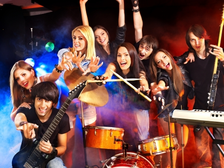 Musical group performance in night club. Lighting effects. Stock Photo - 16084450