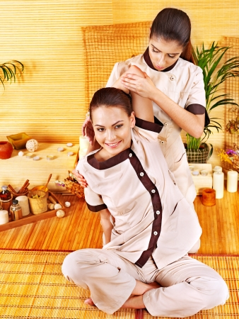 thai yoga: Therapist giving Thai stretching massage to woman. Stock Photo