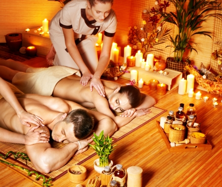 Man and woman relaxing in bamboo spa. Stock Photo - 16084358