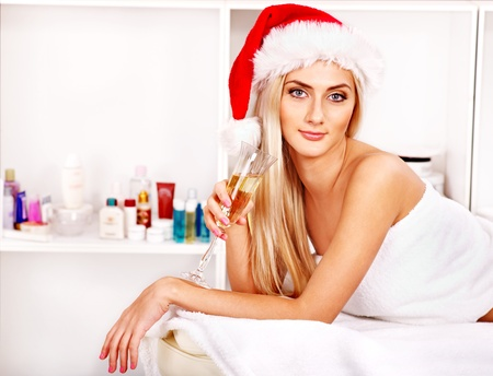 Woman getting massage in Christmas spa.