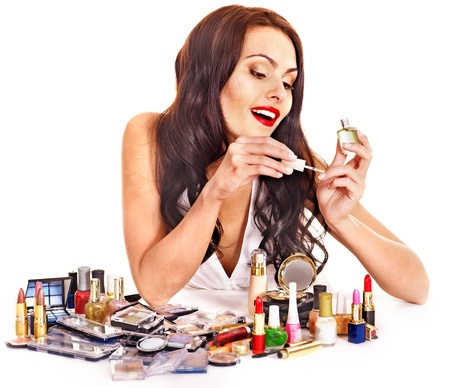 nail varnish: Girl holding makeup brush.  Isolated.