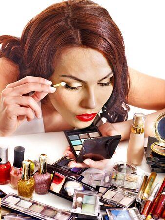 Girl holding eyeshadow and makeup brush.  Isolated. Stock Photo - 16084400