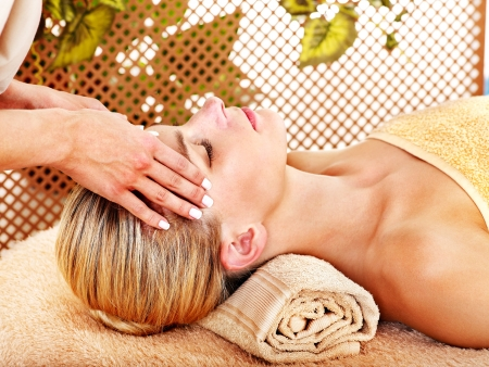 beautician: Woman getting facial massage in tropical beauty spa. Stock Photo