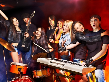 Musical group male and female  performance in night club. Stock Photo - 16084394
