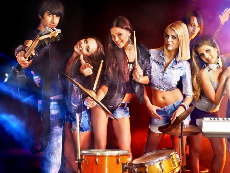 lighting effects musician: Musical group performance in night club. Lighting effects.