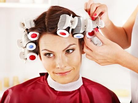 hot rollers: Happy woman wear hair curlers on head.