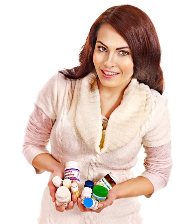 sweater girl: Young woman having pills and tablets. Isolated.