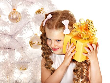 hair bow: Child with gift box near white Christmas tree. Isolated.