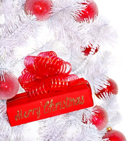 red gift box: White Christmas tree and red gift box. Isolated. Stock Photo