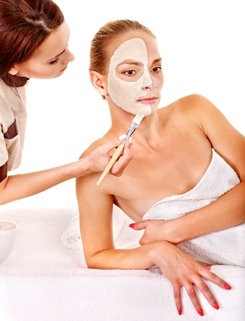 White woman getting facial mask in tropical beauty spa. photo