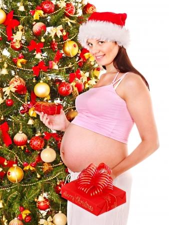 enceinte: Pregnant  woman holding red Christmas box. Stock Photo
